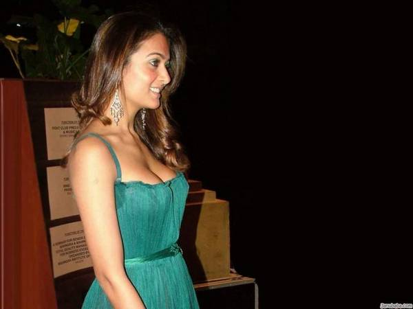 Amrita Arora's busty cleavage are popping out of her dress